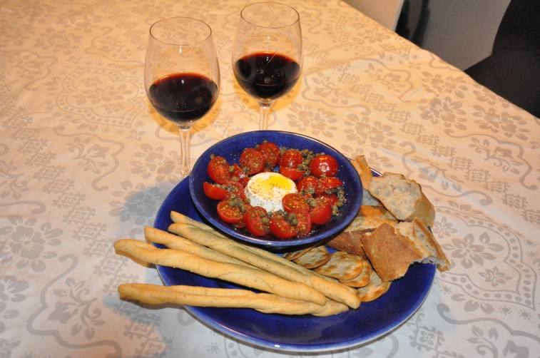 Ricotta olivolja tomater